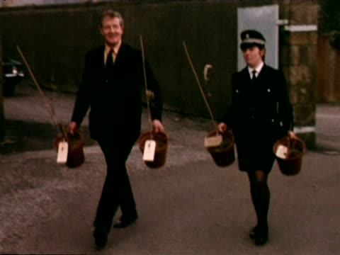 police carry pots found on paul mccartney's land containing cannabis plants into court following his arrest; 1973 - paul mccartney stock videos & royalty-free footage