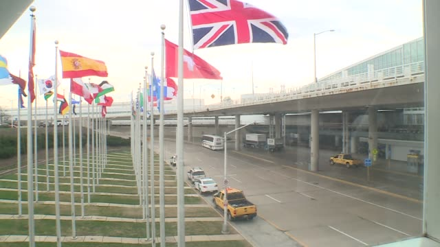 wgn police cars and country flags near chicago's o'hare airport international terminal on march 22 2016 - o'hare airport stock videos & royalty-free footage