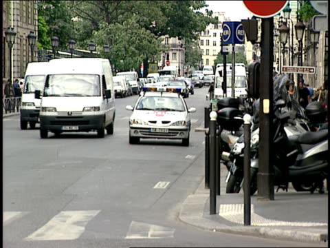 2006 police cars and motorcycles driving on busy city street/ paris, france - france stock videos & royalty-free footage