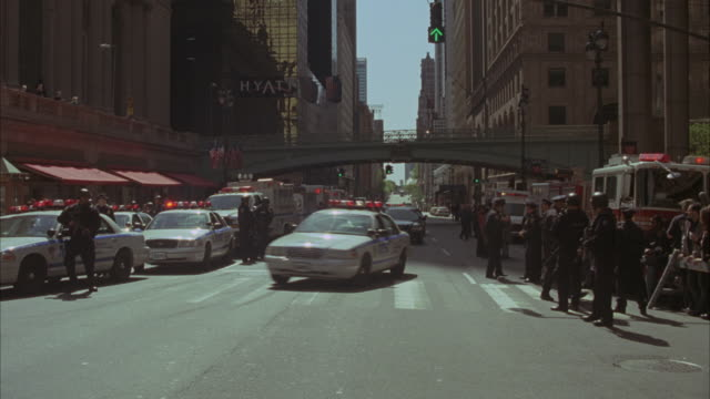 Police cars and SWAT teams arrive at New York City's Grand Central Station and storm the entrance.