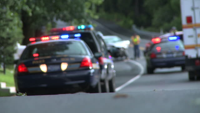 police cars at accident scene - blurred - crash stock videos & royalty-free footage