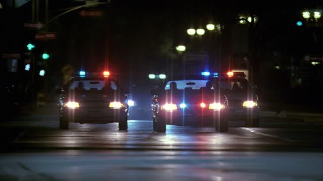 ws police cars escorting limousine / washington dc, usa - パトカー点の映像素材/bロール
