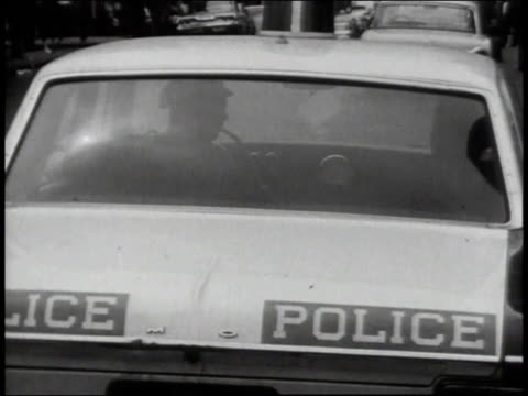 1965 montage police cars on bronx streets / new york city, new york, united states - ufficiale grado delle forze armate video stock e b–roll