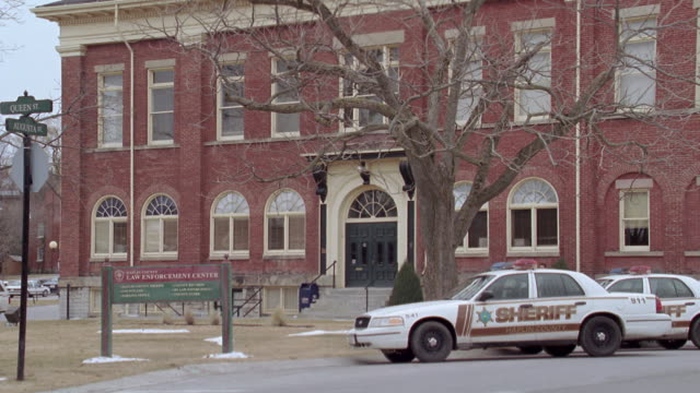 ms police cars parked in lot of city hall / port hope, ontario, canada - brick stock videos & royalty-free footage