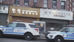 Police cars parked on the street in front of closed stores in Chinatown Manhattan during the city partial lockdown during the coronavirus outbreak.