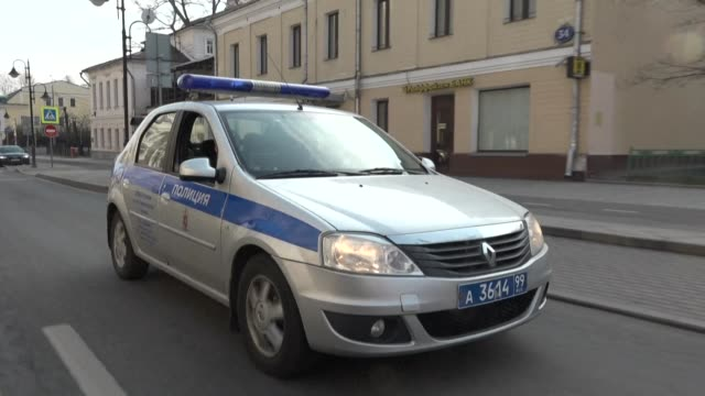 police cars patrol the streets of moscow reminding passers-by of the regulations imposed by the city's mayor sergei sobyanin. despite more stringent... - moscow russia stock videos & royalty-free footage