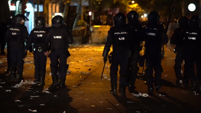 police charge a barricade made by protestors on october 16, 2019 in barcelona, spain. earlier in the week, the spanish supreme court sentenced nine... - barricade stock videos & royalty-free footage