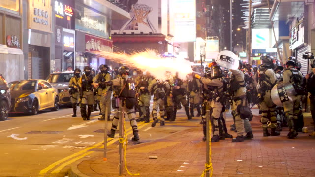 police charge protesters, make arrests and shoot teargas in mongkok, hong kong. - hong kong stock videos & royalty-free footage