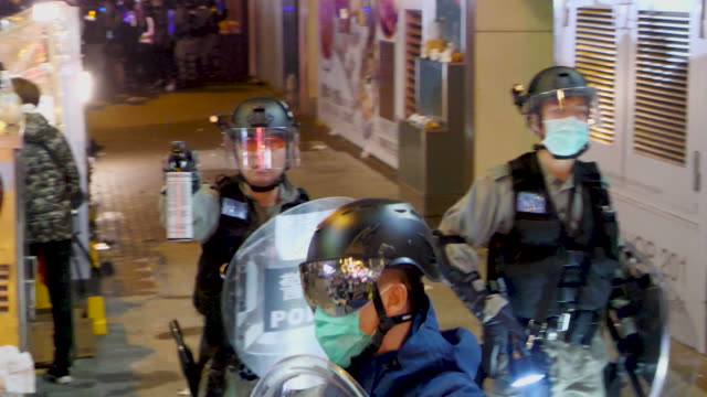 police charge protesters, make arrests and shoot teargas in mongkok, hong kong. - tear gas stock videos & royalty-free footage