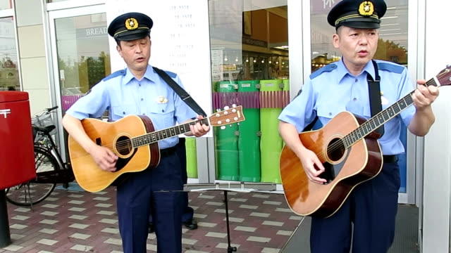 police chief here in northern japan aomori prefecture is now a singersong writer urging the elderly people to be alert against phone swindlers chief... - 警察署長点の映像素材/bロール