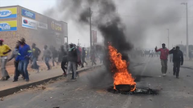 police clash with residents of freedom park and eldorado park who block major roads around the area during a protest to demand housing and other... - unemployment stock videos & royalty-free footage
