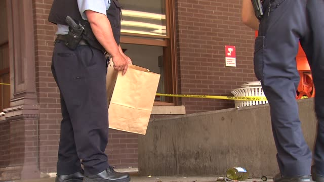 WGN Police Collecting Evidence At Crime Scene on June 23 2013 in Chicago Illinois