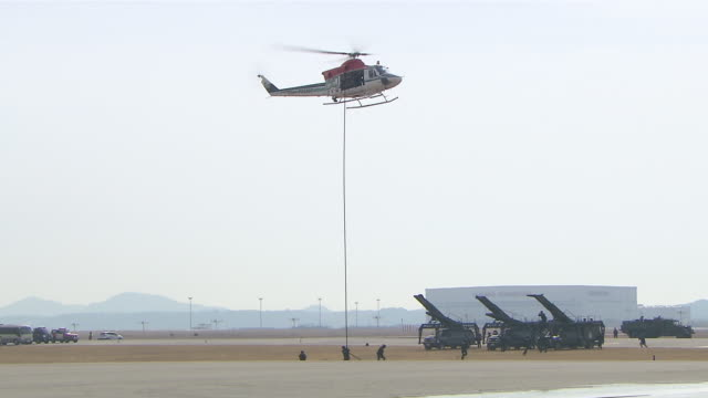 ms police commando repelling down high-lines from helicopter / incheon, south korea - abseiling stock videos & royalty-free footage