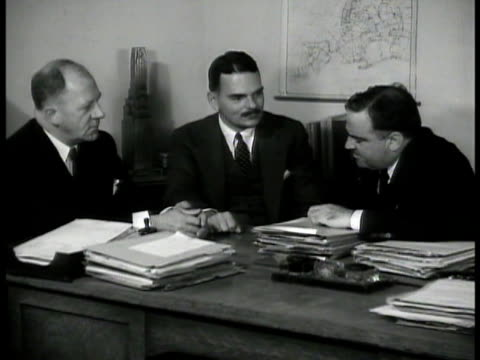 police commissioner lewis j valentine district attorney thomas dewey mayor fiorello h laguardia sitting at desk talking to the others - fiorello la guardia stock videos & royalty-free footage
