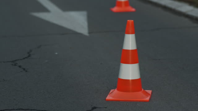 police cone on the road. place of an accident. transport. road traffic. sign - traffic cone stock videos & royalty-free footage