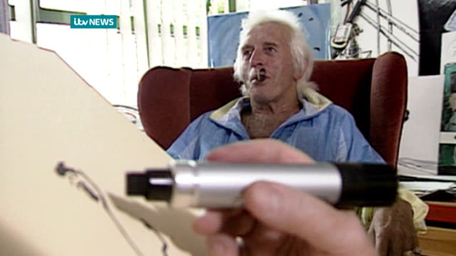 police consider new allegations against rolf harris file date unknown various shots rolf harris sketching jimmy saville and presenting picture to him - rolf harris stock videos and b-roll footage