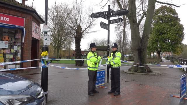 police continue to guard a police forensics tent in place over a bench at the scene connected to the sergei skripal nerve agent attack in salisbury,... - wiltshire stock videos & royalty-free footage
