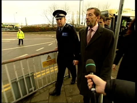 Police continue to question Gloucester man/ Birmingham raids LIB Newport David Blunkett MP along with police officer as arriving to give speech