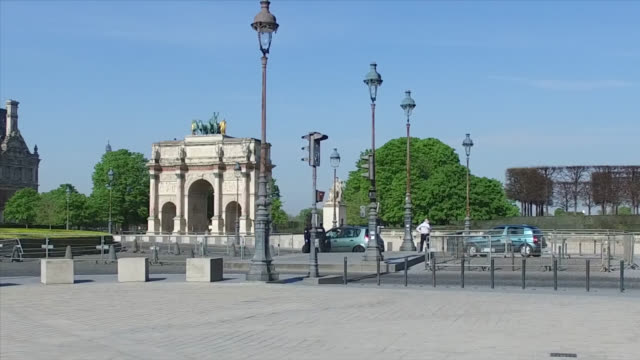 police control in the street, in front of arc de triomphe du carrousel during the coronavirus epidemic on april 8 in paris, france. the country is... - arc de triomphe paris stock videos & royalty-free footage
