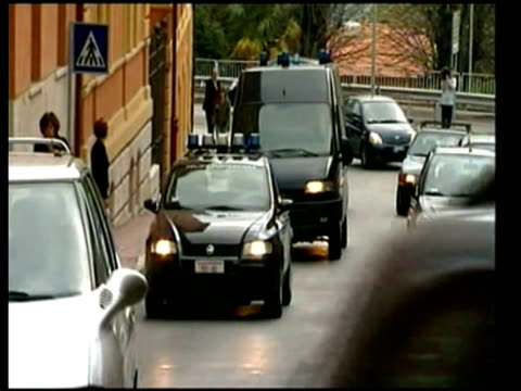 police convoy arriving at court with suspects / back view of police vans entering underground car park guede convicted at meredith kercher murder... - perugia stock videos & royalty-free footage