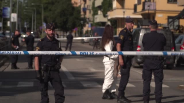 police cordon off a street in stockholm after the swedish lawyer who represented rap star asap rocky was shot and injured friday - friday stock videos & royalty-free footage