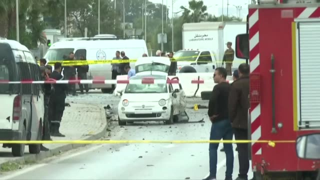 police cordon off an area after a blast near the american embassy in the berges du lac district in the tunisian capital - tunis stock videos & royalty-free footage