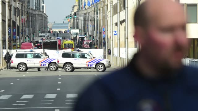 police cordon off the area surrounding brussels maalbeek metro station after a deadly blast explodes shortly after two other blasts at the citys... - surrounding stock videos & royalty-free footage