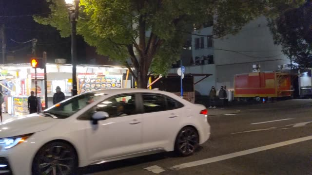 police cordon off the area where portland police tend to the victim of a fatal shooting after the incident near a clash between far-right activists... - portland oregon stock videos & royalty-free footage