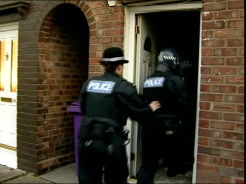 police crackdown on illegal weapons england liverpool ext various of police officers breaking into house during dawn raid hunt for illegal guns... - merseyside stock videos and b-roll footage