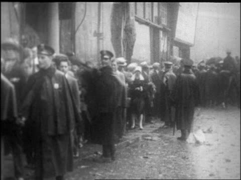 b/w 1926 police crowd in rain waiting to see body of rudolph valentino / nyc / newsreel - 1926 stock videos & royalty-free footage