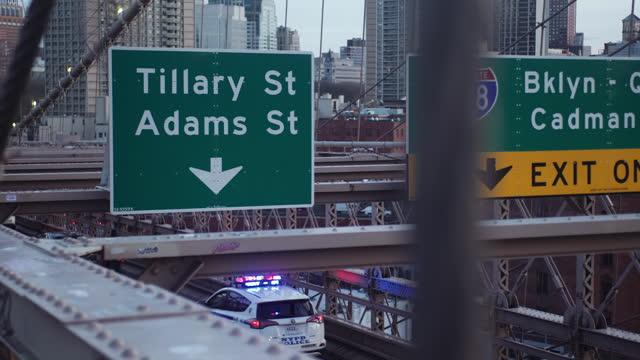 police cruiser crossing the brooklyn bridge - manhattan stock videos & royalty-free footage