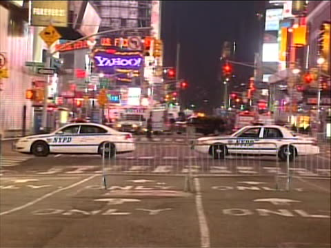 police cruisers block the road into times square because it is shut down and evacuated when a bomb was discovered in a car there was an attempted car... - united states and (politics or government) stock videos & royalty-free footage