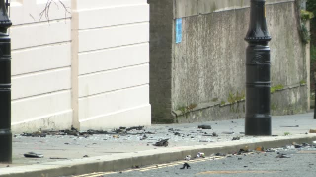 police dealing with two security alerts in londonderry in wake of car bomb northern ireland londonderry ext street with debris from bombed car - privatfahrzeug stock-videos und b-roll-filmmaterial