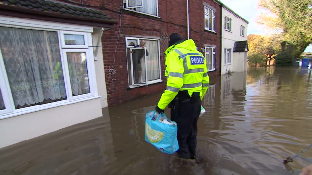 police deliver emergency food supplies to residents stranded in flooded houses on the village of fishlake, doncaster - village stock videos & royalty-free footage