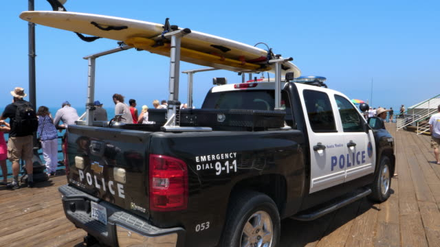 Police department rescue truck with surfboard on duty on Santa Monica Pier in Los Angeles, California, 4K