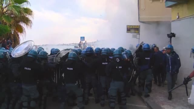 Police deploy tear gas at dozens of protesters as demonstrations against the G7 summit in GiardiniNaxos escalate Protesters wore red tshirts and...