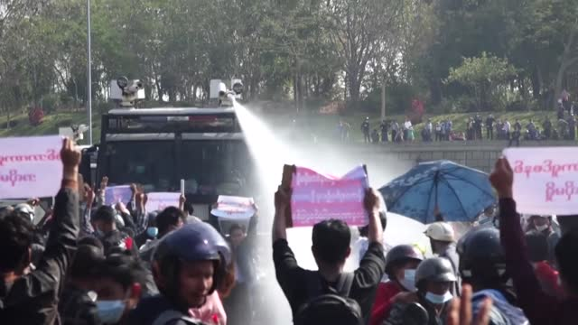 police deploy water cannon briefly against protesters in myanmar's capital naypyidaw as the junta faces its biggest opposition yet to last week's... - army stock videos & royalty-free footage