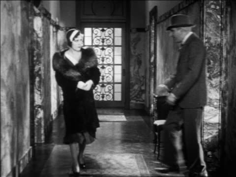 b/w 1931 police detective (eddie kane) accosting irene dunne in hallway / feature - 1931 stock videos & royalty-free footage