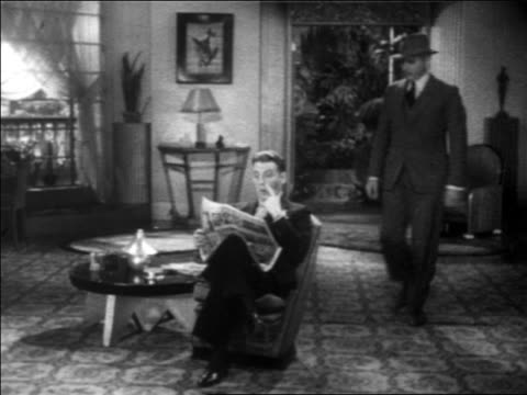 B/W 1931 police detective (Eddie Kane) talking to Frank Fay getting up from armchair / feature