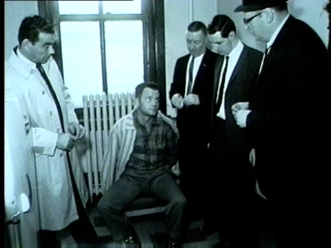 police detectives bring suspect in for questioning in chicago in 1962 - 1962 stock videos & royalty-free footage