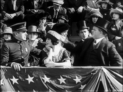 B/W 1922 police + dignitaries on sidelines at parade screaming + flinching in fear / feature