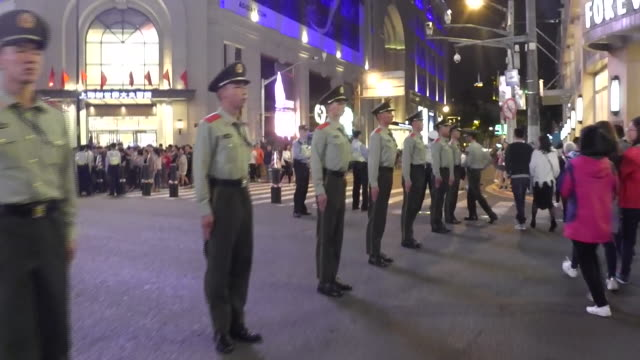 police direct traffic and pedestrians on nanjing road in shanghai. - nanjing road stock videos & royalty-free footage