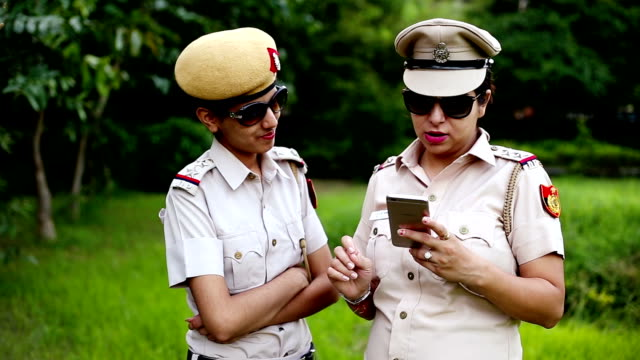 police discussion about something by using smartphone - police force stock videos & royalty-free footage