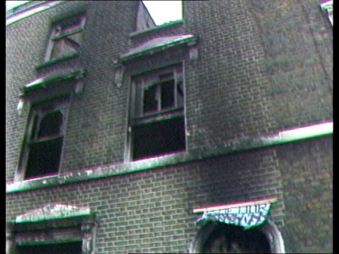 police disuade national front from planned march england london new cross zoom into wreath on front steps of burnt out house pull back from... - national front stock videos and b-roll footage