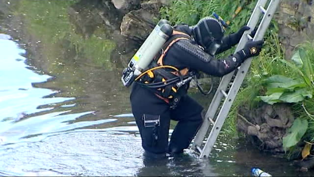 police diver into river ayr to search for further remains and officers standing above watching - ayr stock videos & royalty-free footage