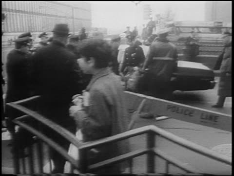 b/w 1967 police dragging hippy man at antiwar rally by united nations / nyc / newsreel - peace demonstration stock videos and b-roll footage