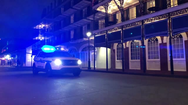 police drive down empty bourbon street as louisiana governor john bel edwards orders bars gyms and casinos to close until april 13th due to the... - casino stock videos & royalty-free footage