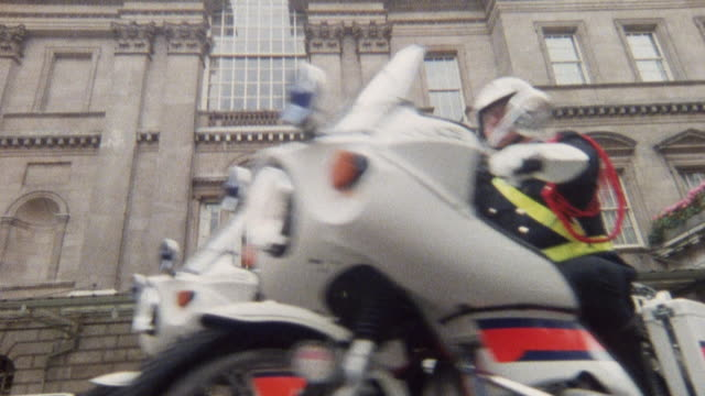 1985 montage police escort a limousine through a city street / london, england† - 1985 stock videos & royalty-free footage