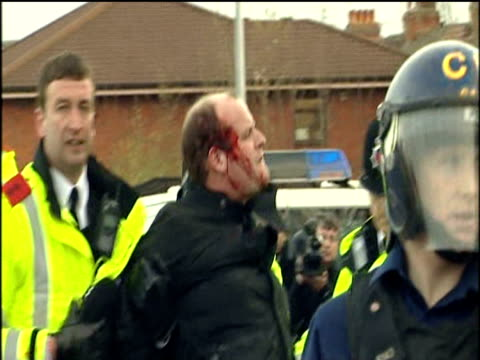 police escort football fan with bloody face away from violent disturbances at old trafford football ground prior to manchester united vs roma... - hooligan stock videos & royalty-free footage