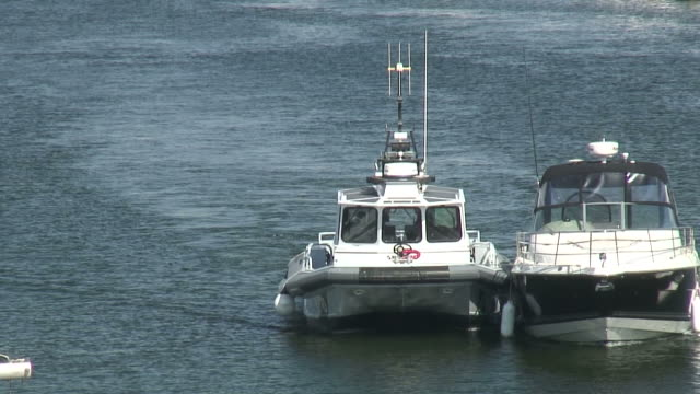 (hd1080i) police escort - police boat stock videos and b-roll footage